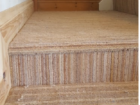 Sometimes the customer wants a slightly different look. This stripe carpet fitted in Plymouth has some interesting directions.