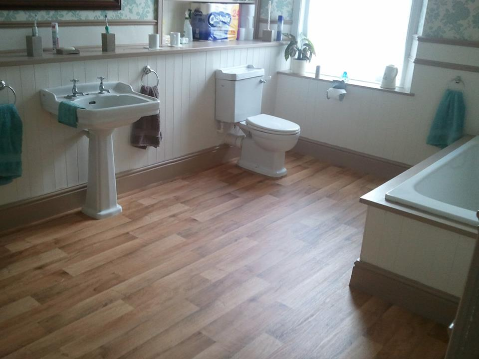 Vinyl fitted to large bathroom in Victorian house in Tavistock. Always  nice to have wood panel vinyl in such an historic building