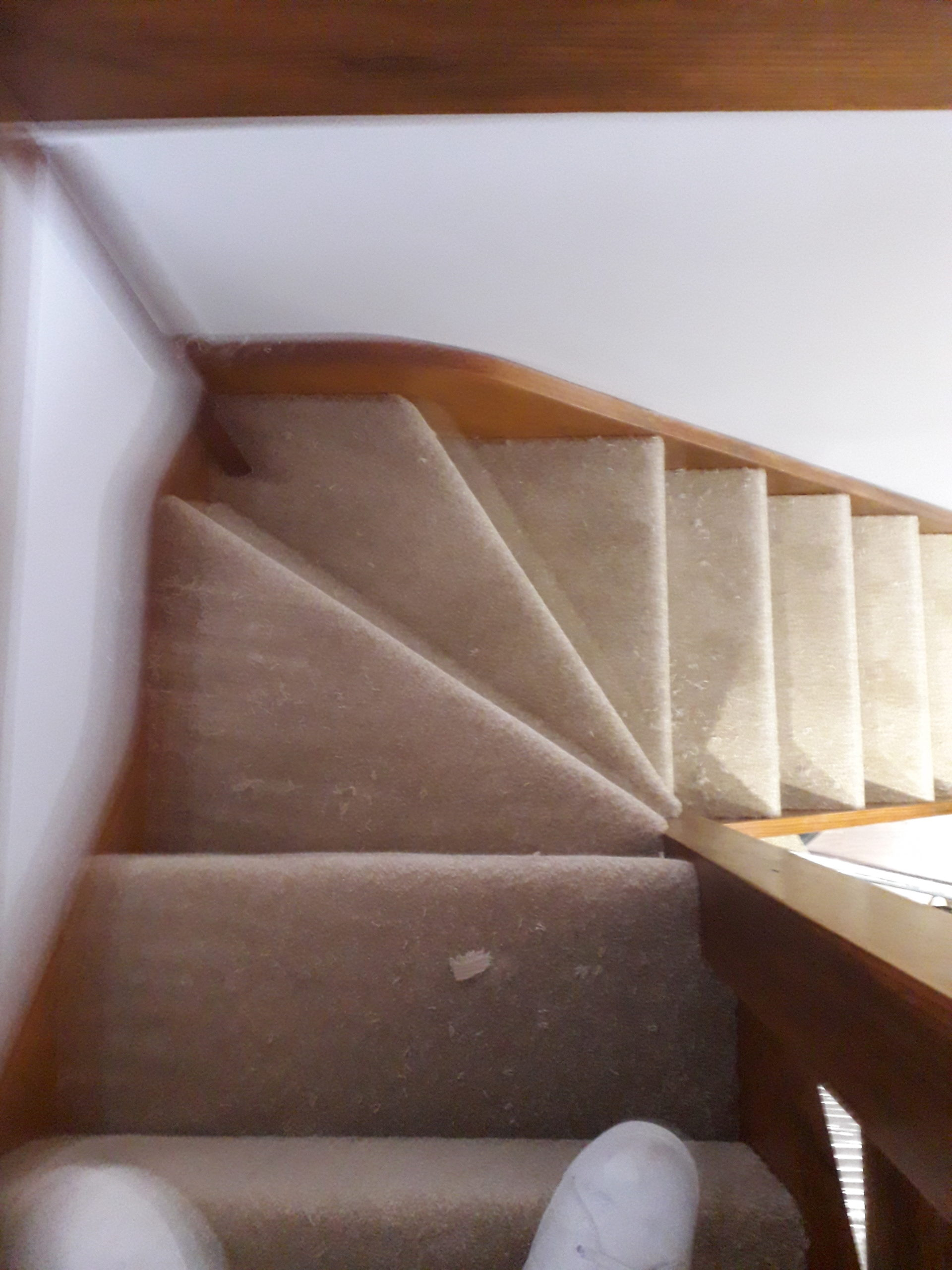 Winding staircase fitted with cut pile carpet in Plymouth.