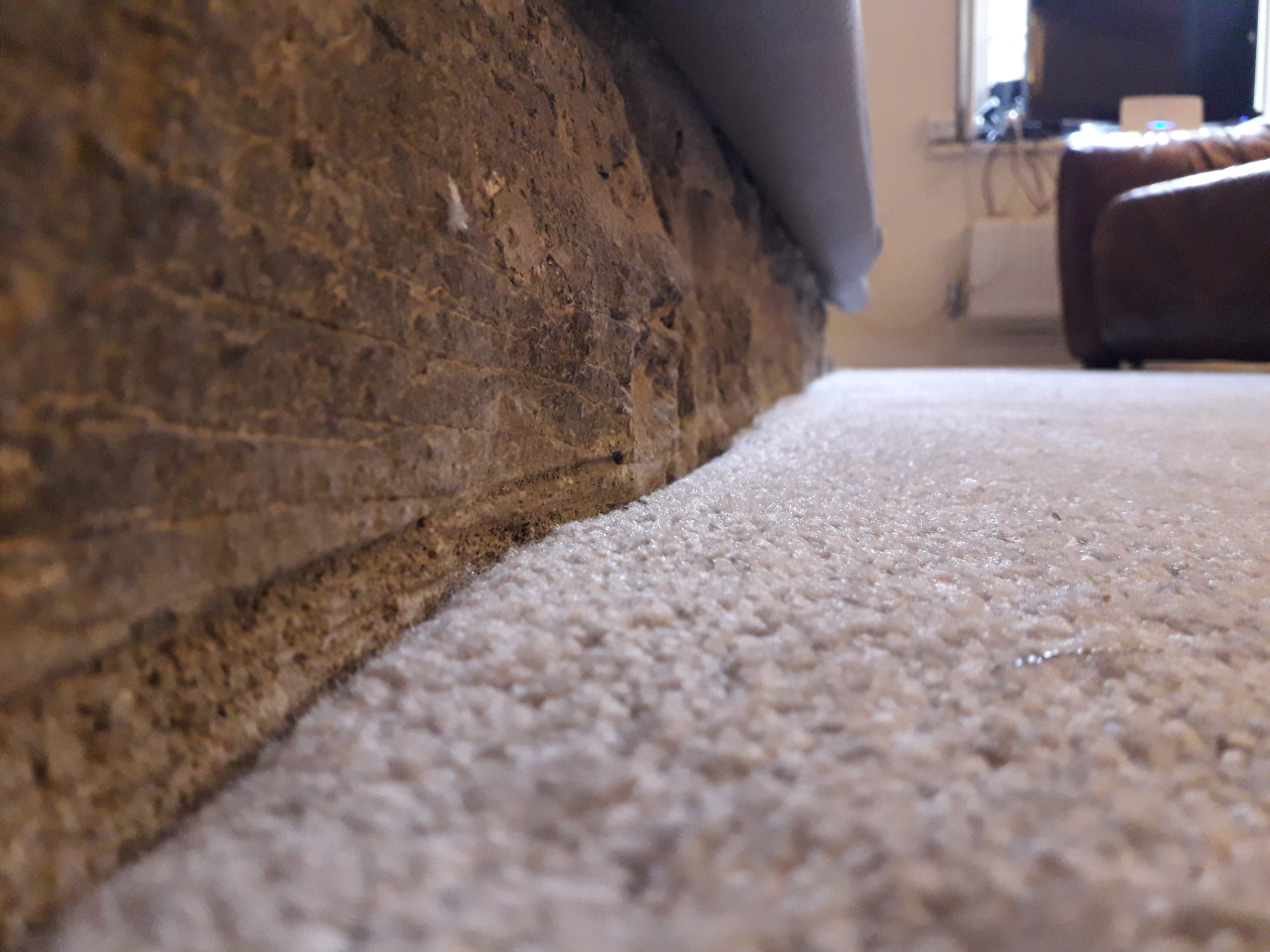 Low profile carpet fitted around stone fireplace in Gunnislake.